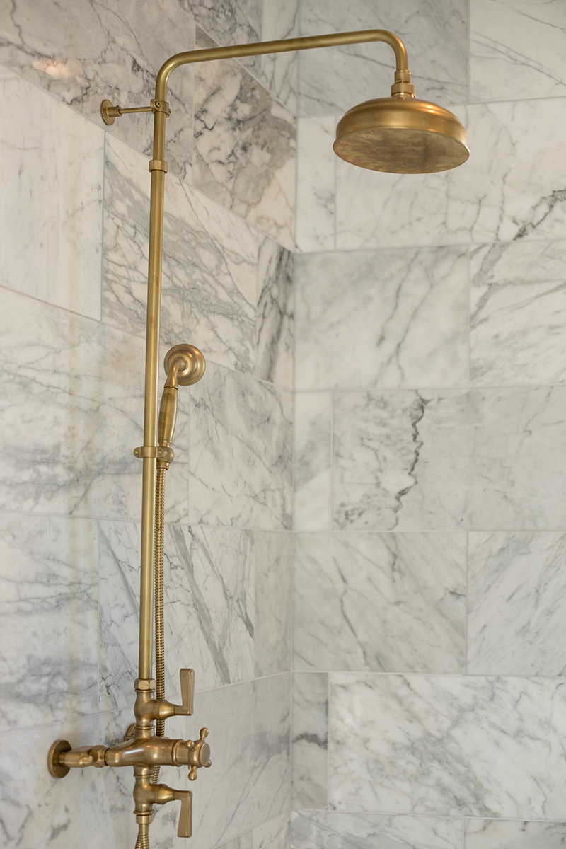master suite, shower with marble, gold fixture