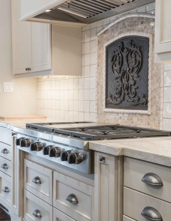 French Norman style kitchen large stove framed back splash
