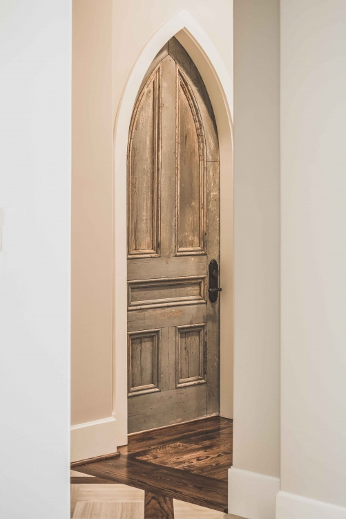 Custom French Normandy Style Home, arched antique door