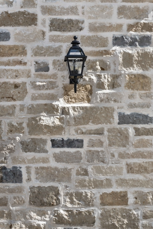 French Norman Style Home, outside brick, sconce