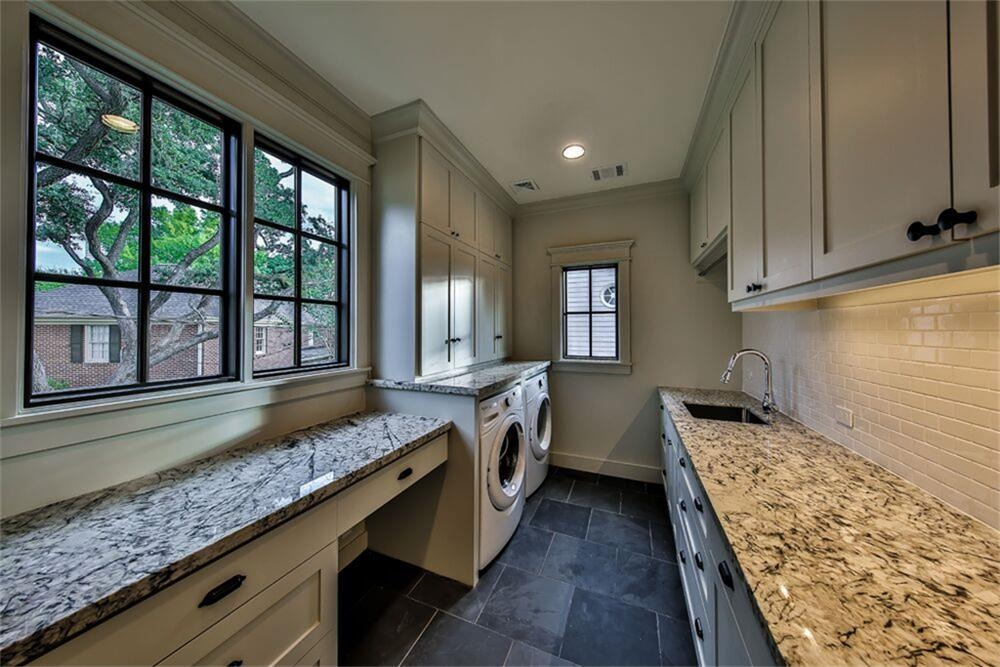 Mirador large laundry room with extra space and subway tile