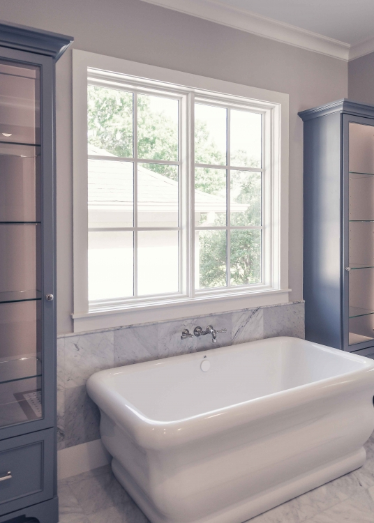 custom tub with faucet in the wall, custom woodwork