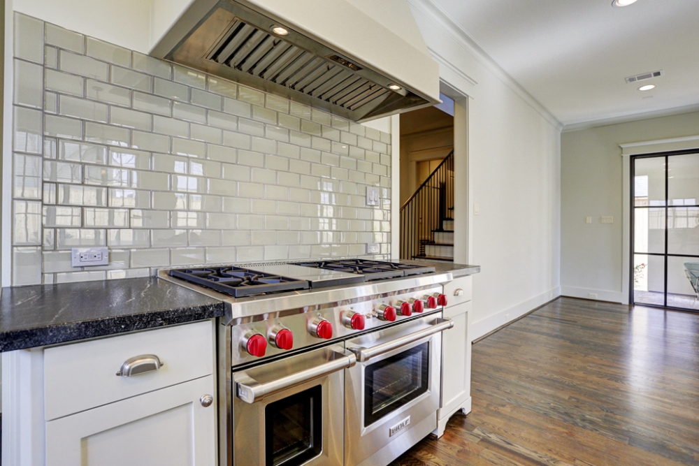 stove with red knobs, custom kitchen