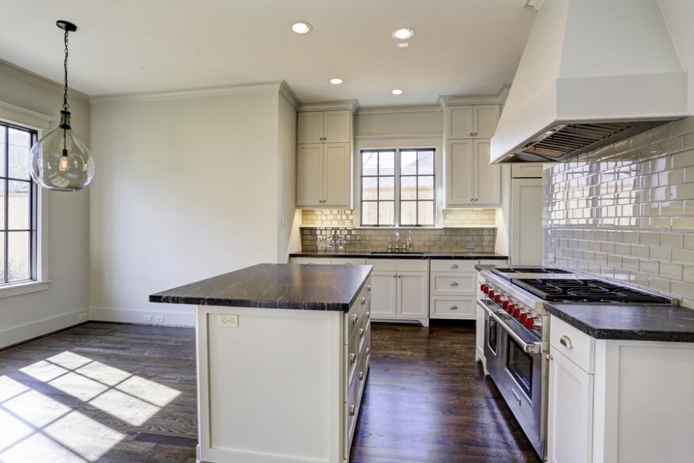custom kitchen, white cabinets, gray-green subway tiles, dark wood floors