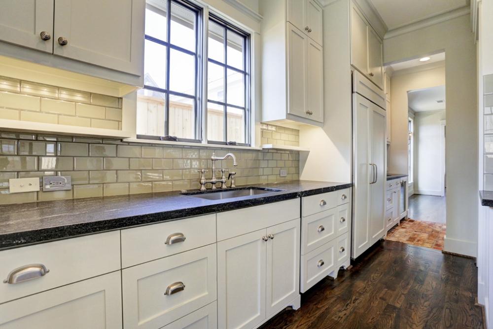 custom kitchen, white cabinets, gray-green subway tiles