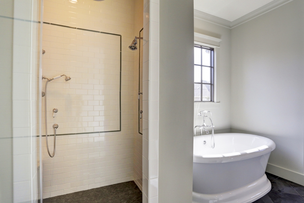 master bathroom suite with walk-in shower and bath tub
