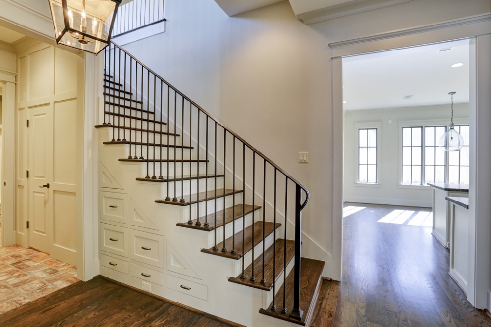 west university custom home, staircase with built in storage