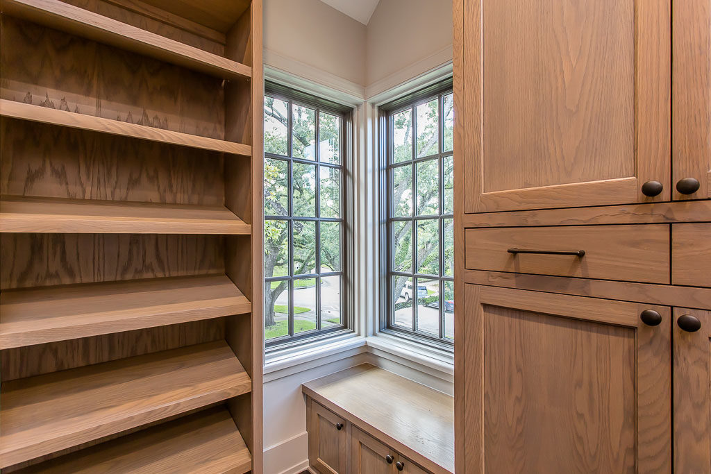 custom river oaks closet with bench seating