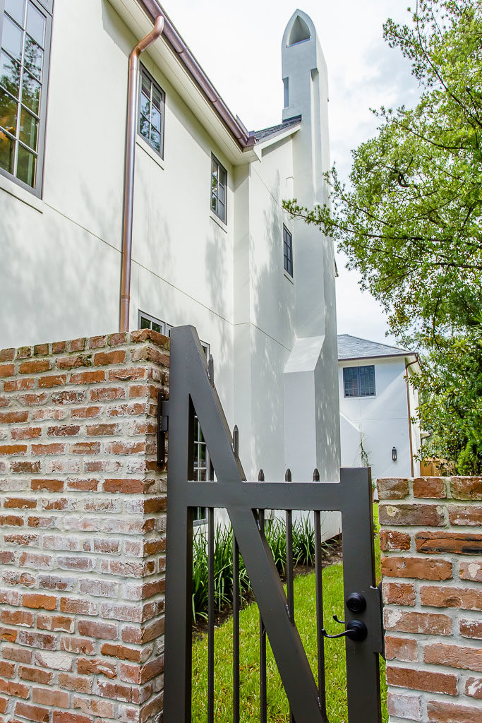 Del Monte Park River Oaks, outside custom gate with brick privacy fence