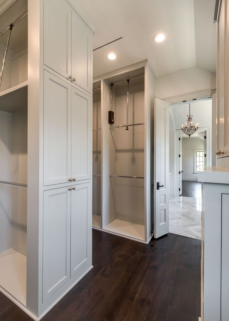 river oaks custom closet, her closet with custom cabinetry