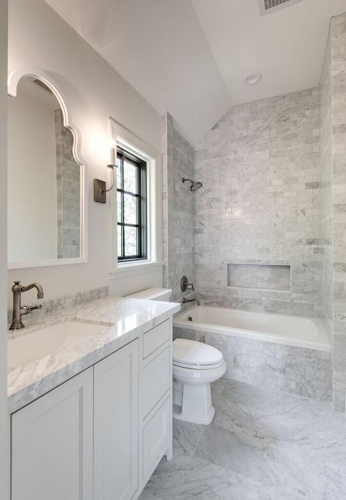 river oaks custom bathroom with White carrera marble floors, antique nickel faucet