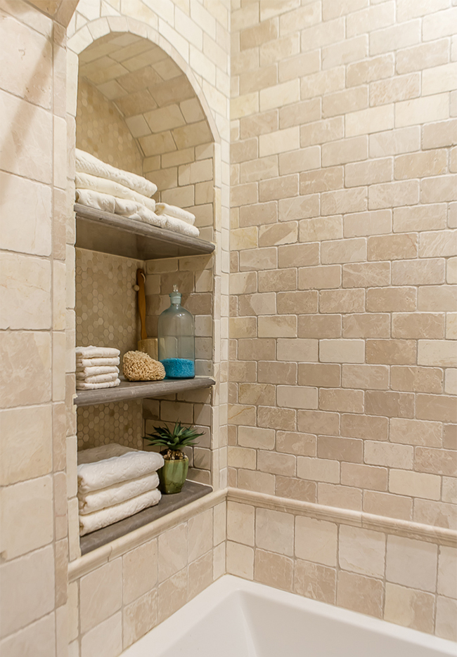 bathroom with detailed tile work
