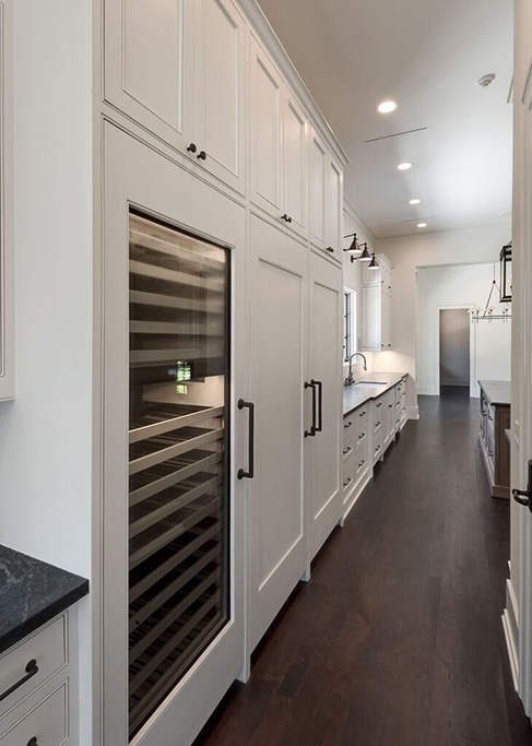 custom home with service hall and butlers pantry