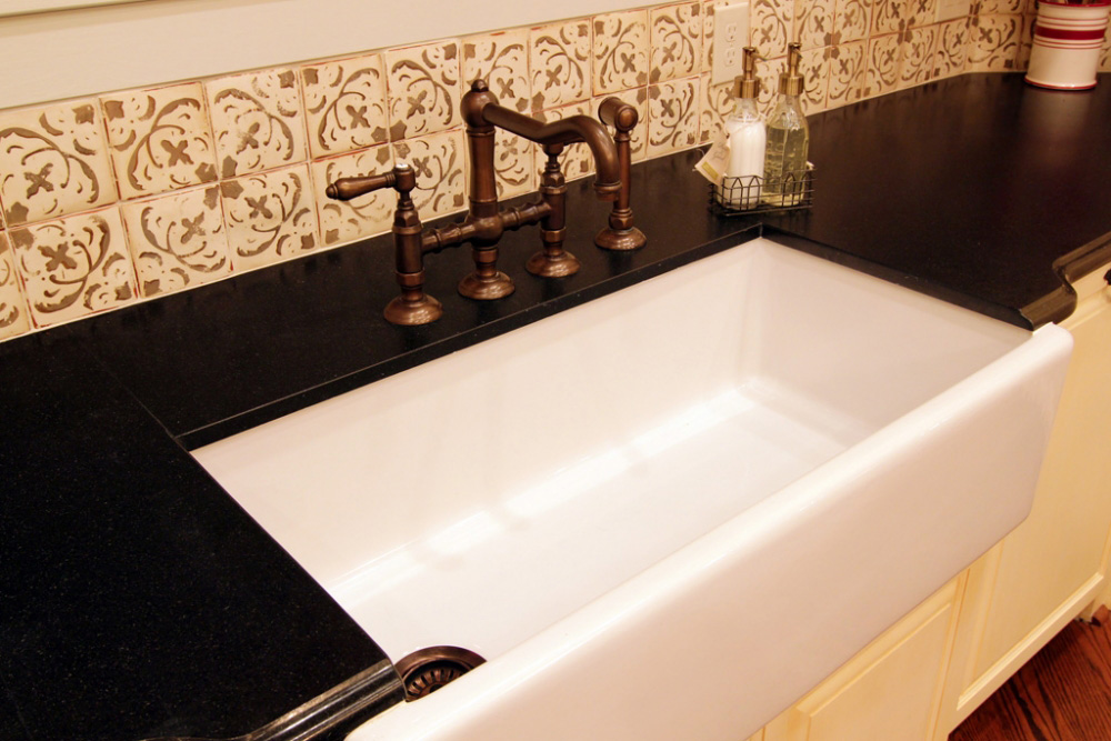 Provencal Style River Oaks, farm sink with custom cabinets