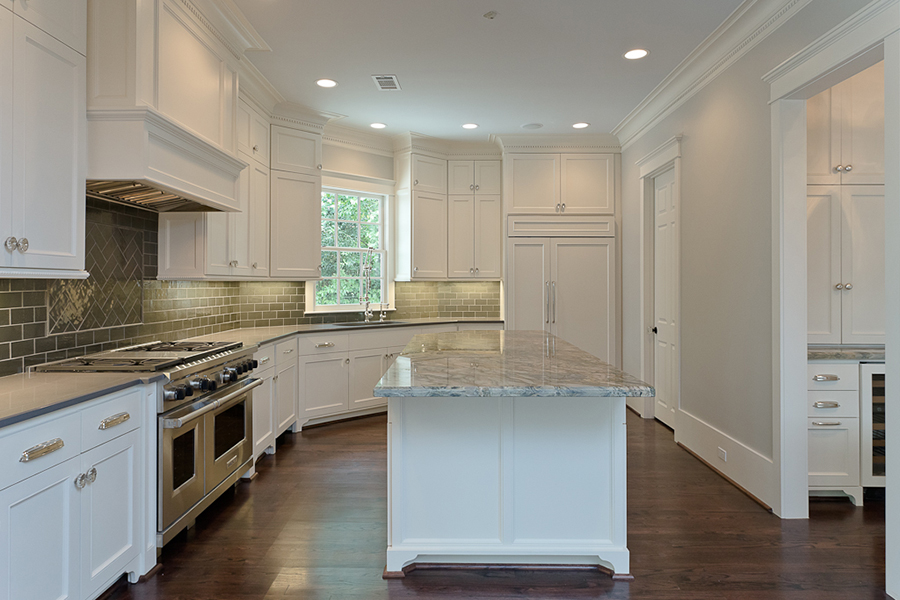 River Oaks custom kitchen with green subway tile