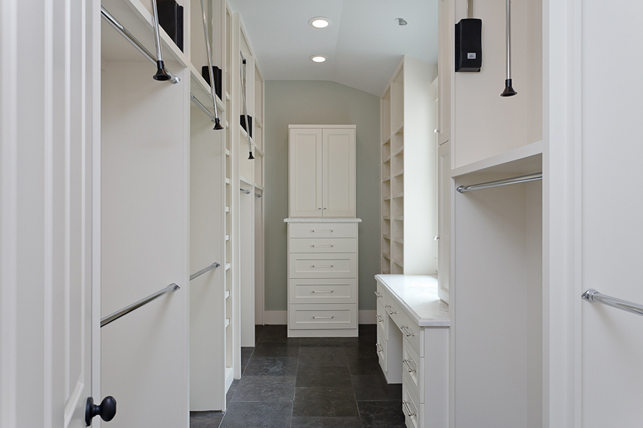large master closet with vanity and window, California style closet in River Oaks