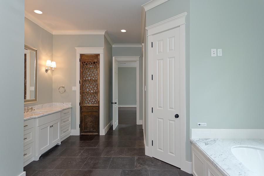 Traditional-Custom-River-Oaks bathroom with custom wood door