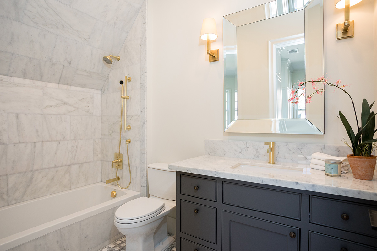 custom home secondary bath with Carrera marble counter-tops
