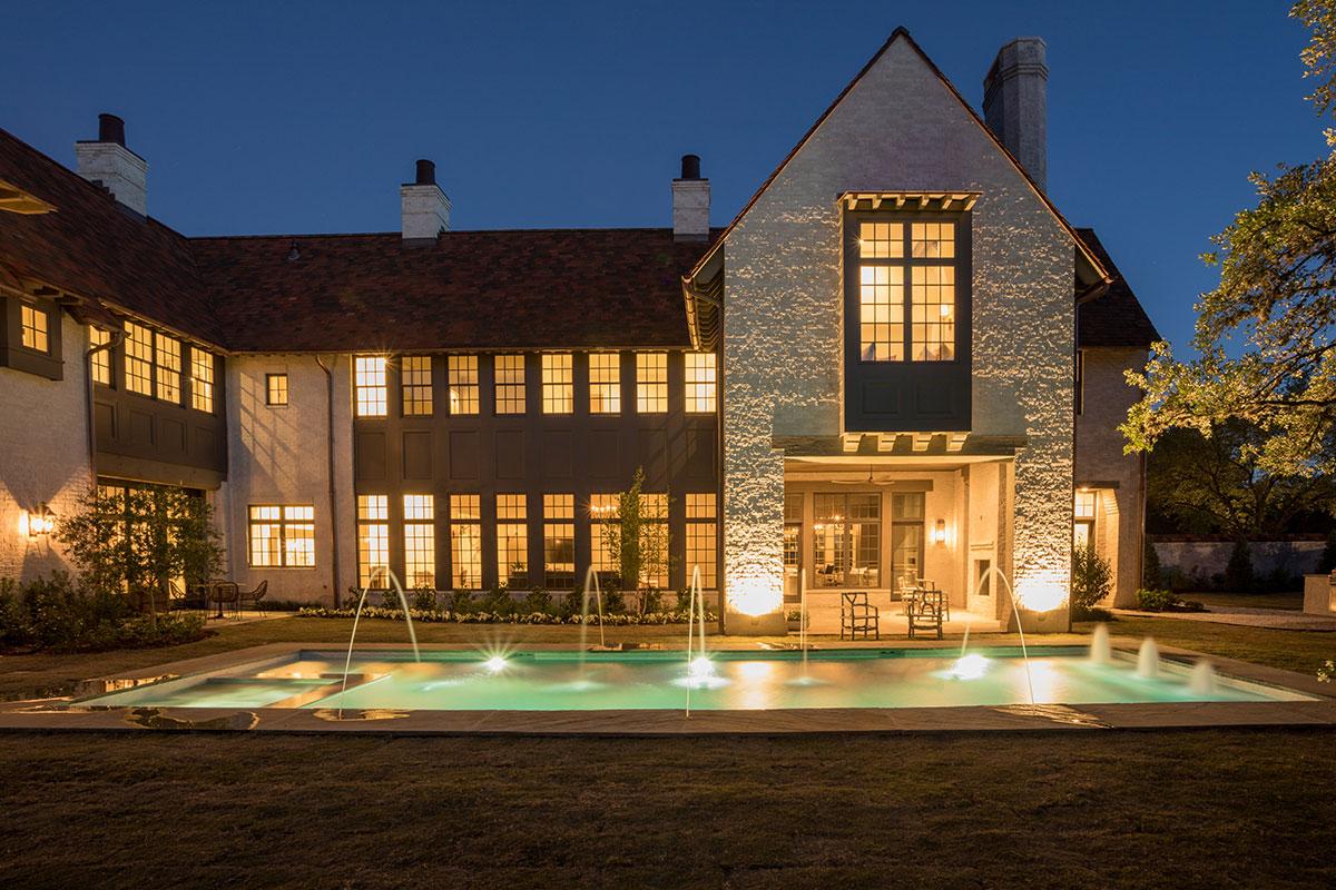 Mirador-Builders-River-Oaks-Estate, back view at night shows custom lighting