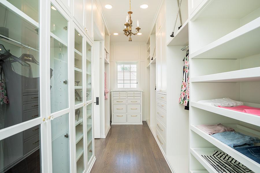 hers closet with glass doors
