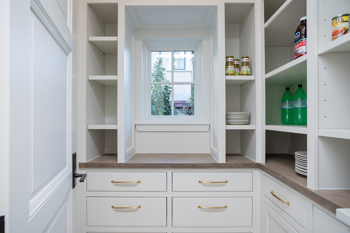 custom home builder pantry with stay storage, white oak counter