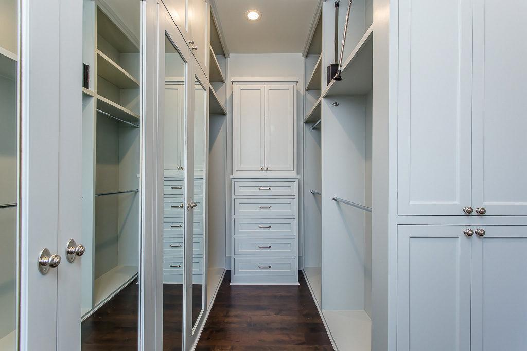 American Vinacular custom home builder, spacious hers closet with built-in dresser