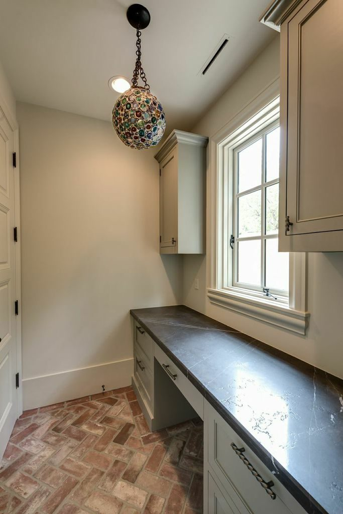 custom home with small office off the kitchen