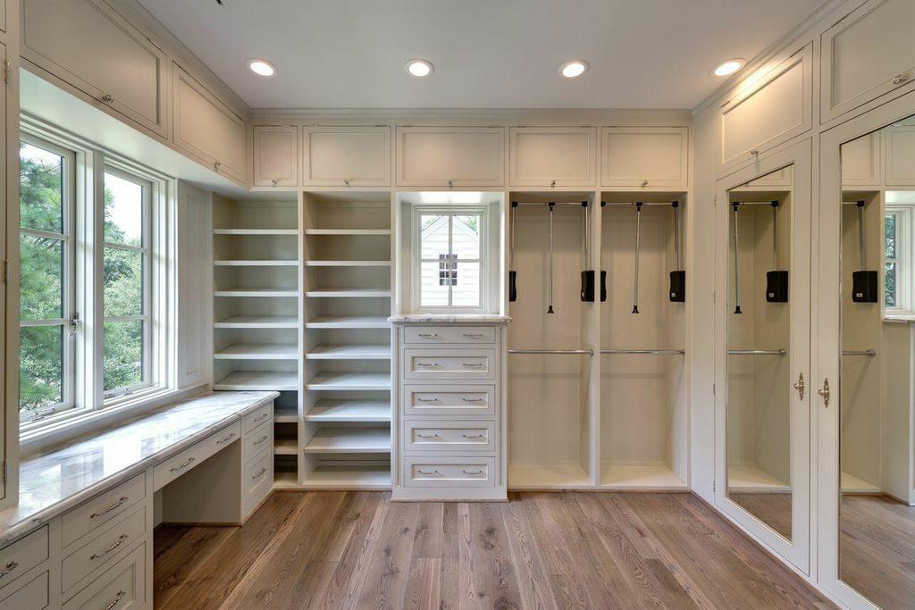custom home design with large master closet, wood floors, custom built-ins