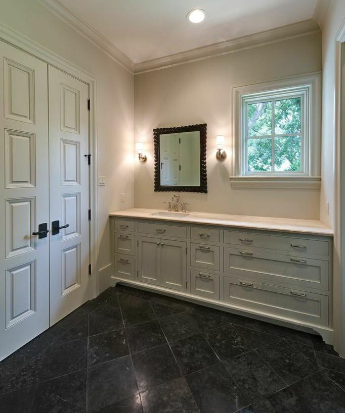 custom doors in large restroom, dark floor