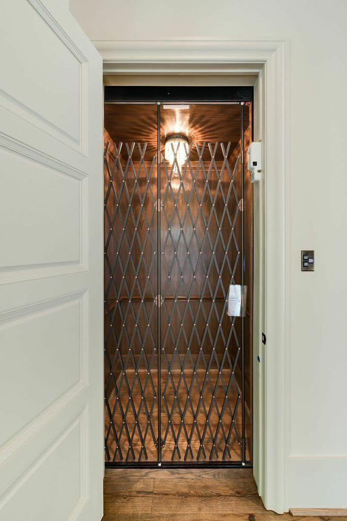 custom personal elevator with walnut paneling