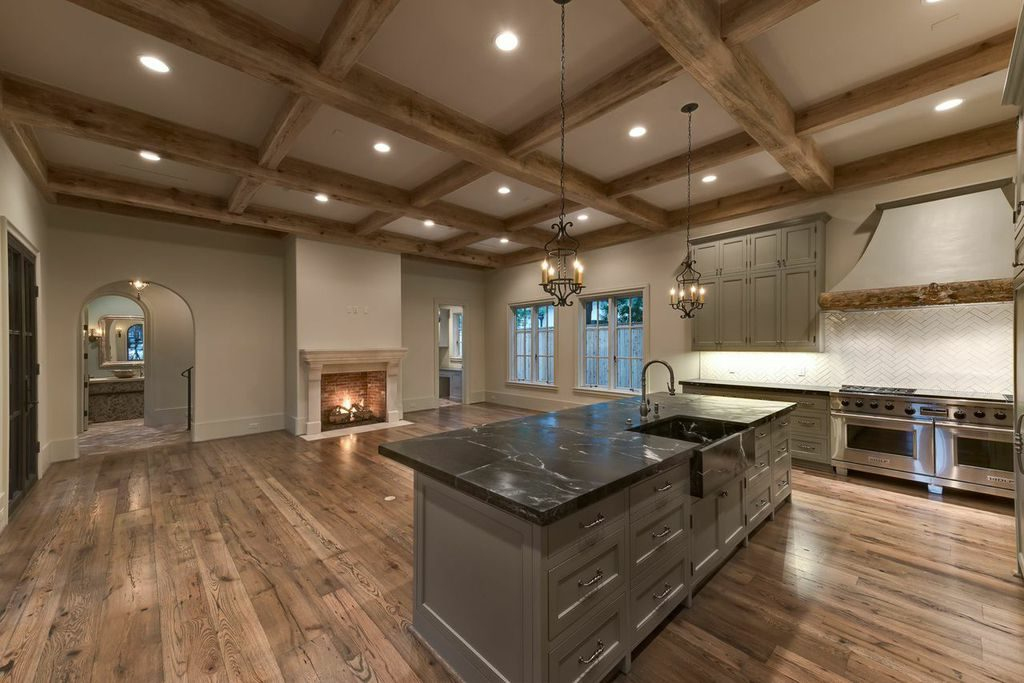 large custom great room with over-sized island and fireplace