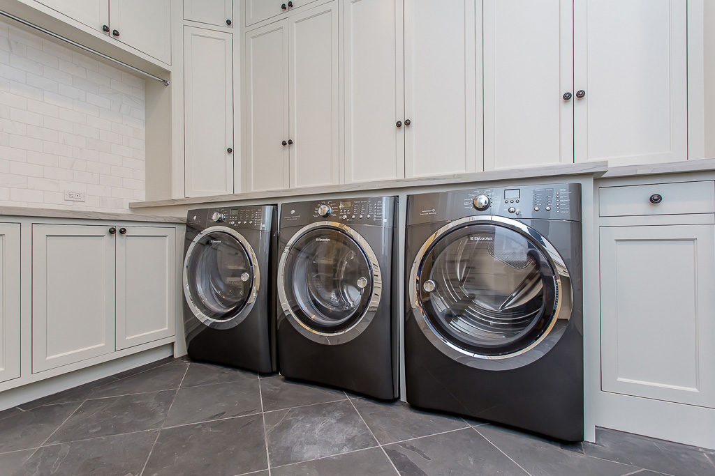 river oaks custom home with huge laundry room