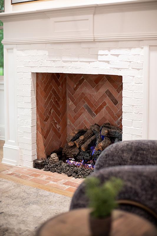 custom fireplace with brick detail