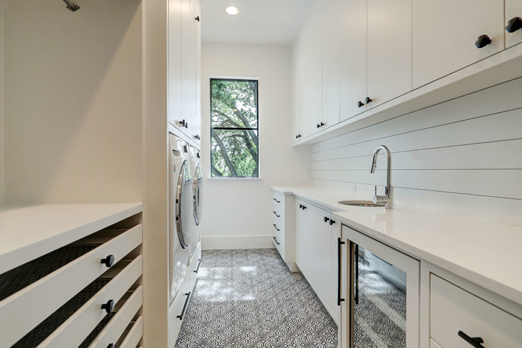 utility-room-with-built-ins-and-custom-tile